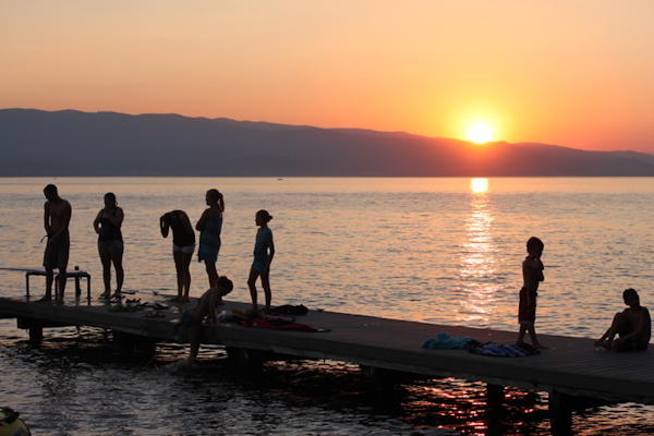 summertime sunset in flathead lake, montana