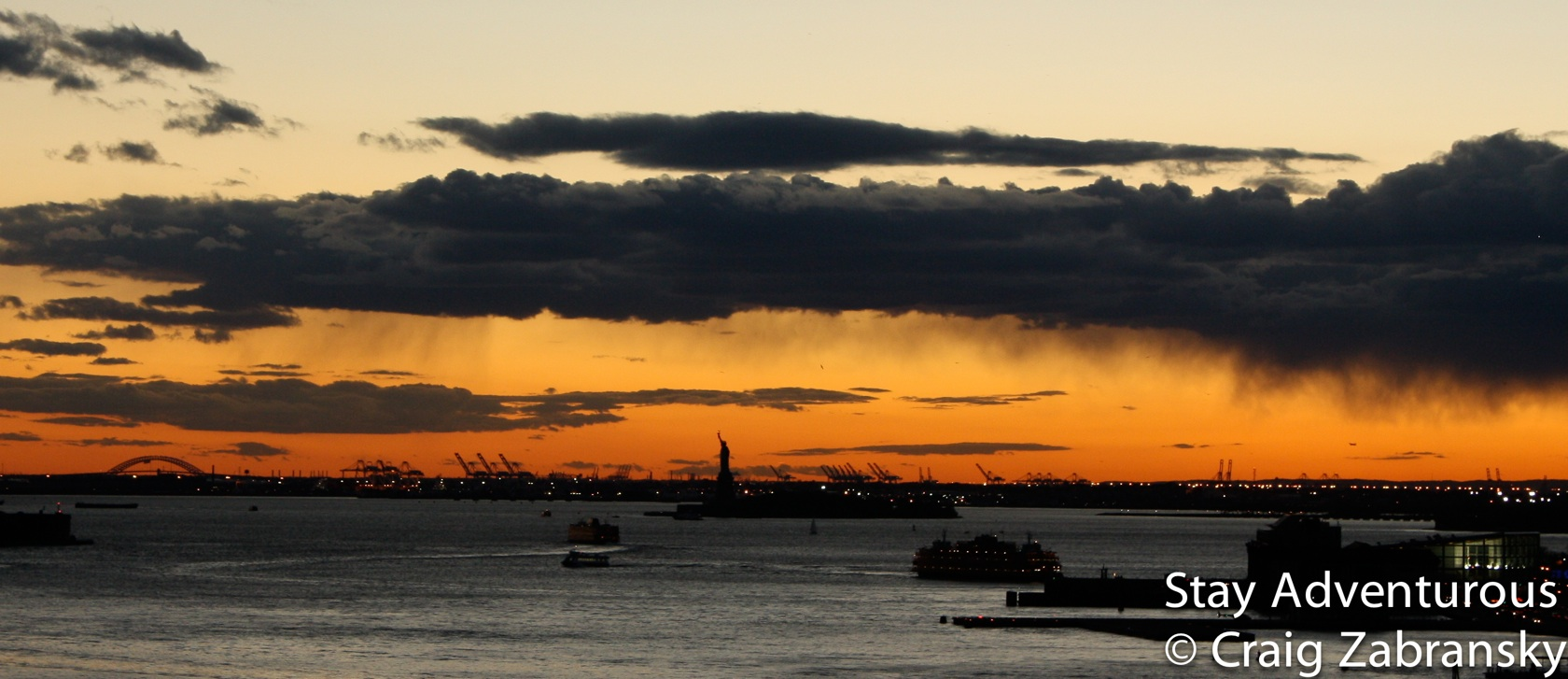 Statue of Liberty at sunset from the Brooklyn Bridge in New York