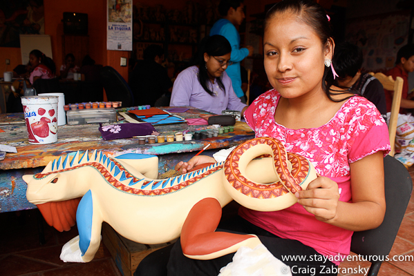 painting the colorful Alebrijes of San Martin Tilcajete, Oaxaca, Mexico