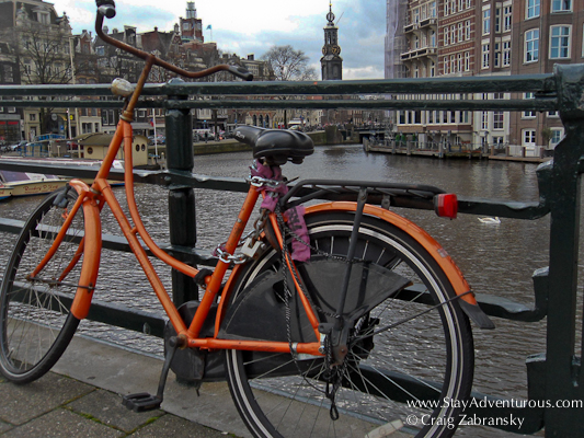 a bike on a canal bridged in Amersterdam Holland