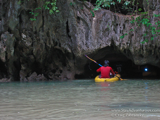 entering a cave in a sea kayak in Thailand