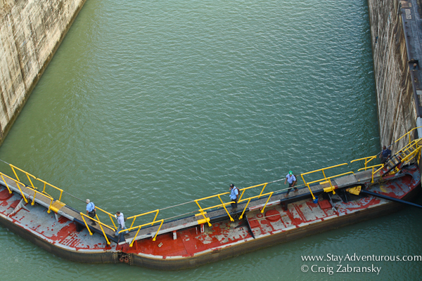 workers walk over the Gatun Lock, Panama Canal