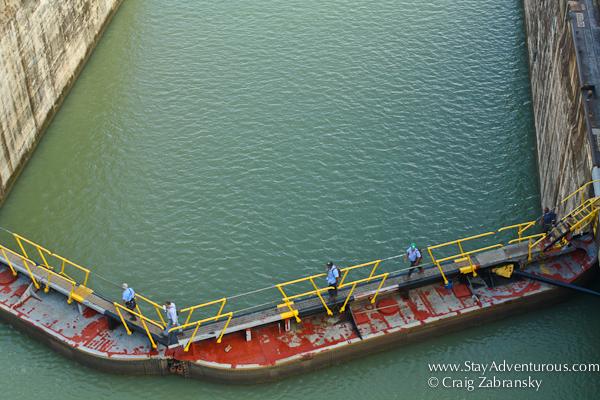 workers walk over the Gatun Lock, Panama Canal