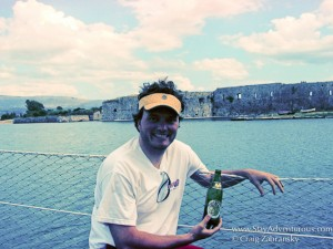 Craig with Mythos Beer on Ionian Sea