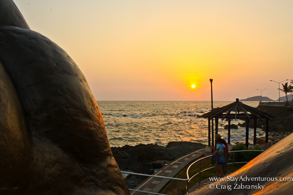 sunset on the malecon of mazatlan between the arch of the mermaid