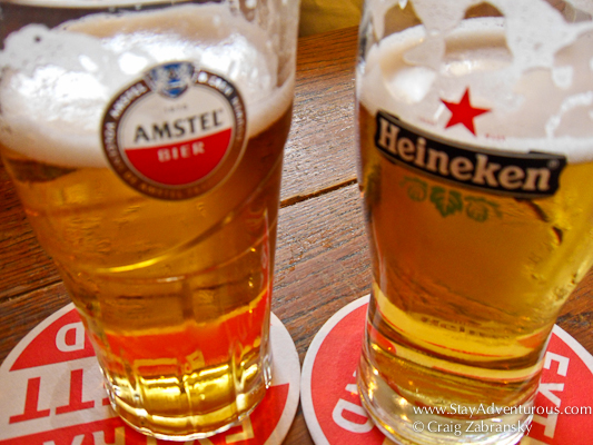 glass of Heineken and glass of Amstel in Amsterdam