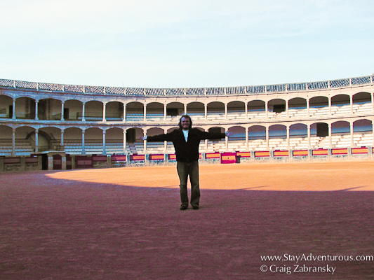 Craig standing in the bullring of Ronda