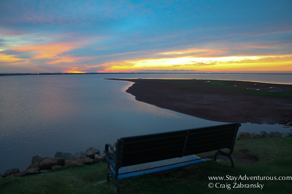the bench along lake hefner, oklahoma city at sunset