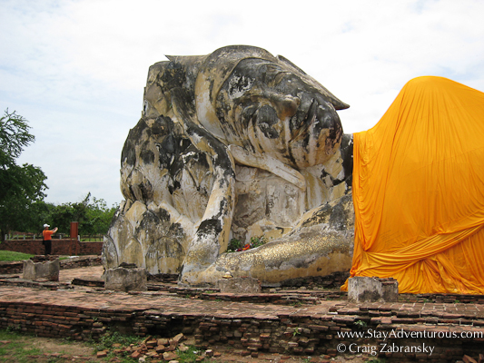 a photo of the large reclining Buddha at Ayutthaya the old Thai Capital outside Bangkok