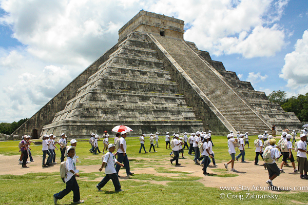 A tour visiting the Pyramid of Kukulcan at Chichen Itza