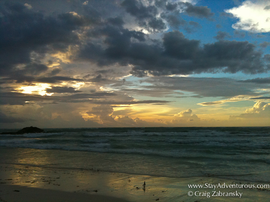 a mayan sunrise from tulum, mexico