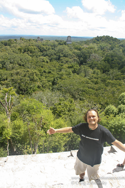 Craig Zabransky of Stay Adventurous on top of Templo IV Pyramid at the Mayan Ruins of Tikal, Guatemala