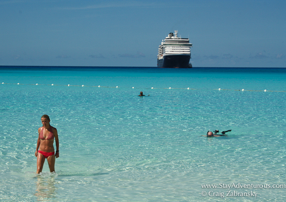 half moon cay with view of cruise ship and bikini
