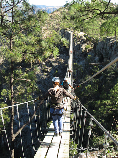 walking the suspension bridge at the Adventure Park found at the Copper Canyon in Chihuahua, Mexico