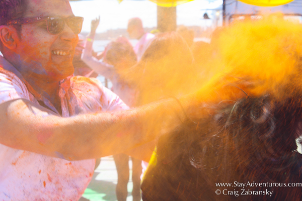 A cloud of orange and yellow at the Holi Festival created by InMedia in New York on the Hornblower's The Respect