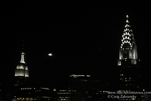 the new york skyline at night from One UN New York in Murrary Hill, New York