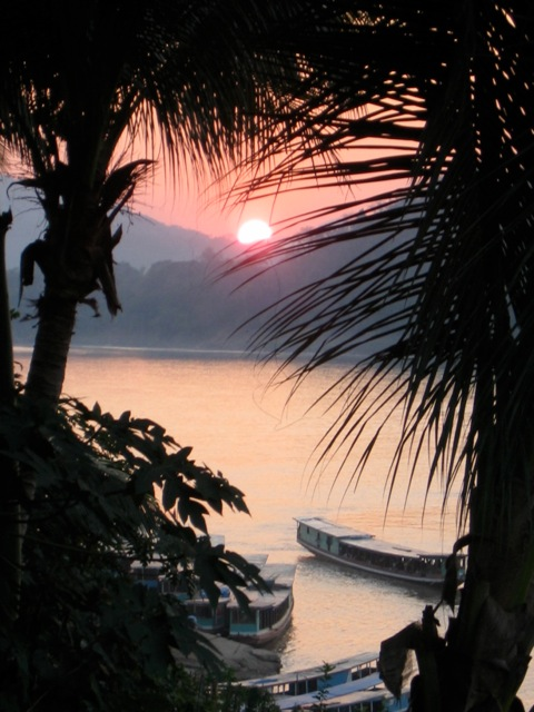 the sunset in Laos on the Mekong River