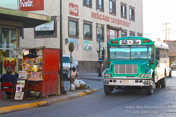 the city streets of Juarez with a bus by the main indoor market