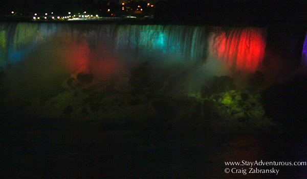 the american falls at niagara falls at night from the canadian side of the natural wonder
