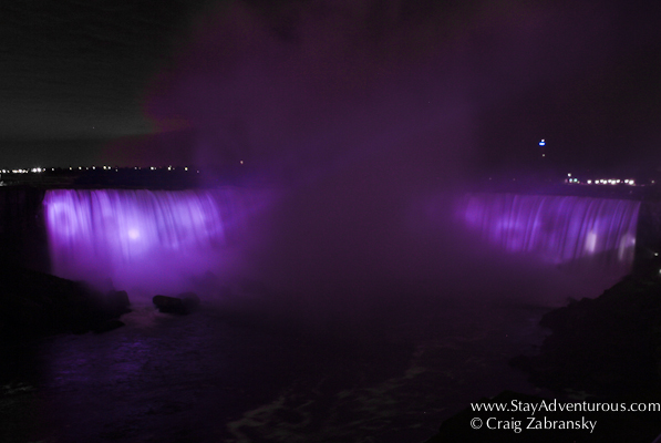 the Horseshow Falls (Canadian Falls) at Niagara Falls at night from the Canadian side of the natural wonder