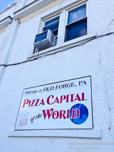 the sign - pizza capital of the world. it was outside Revello's Pizza in Old Forge, PA