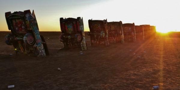 Cadillac ranch at sunset by Maria Falvey