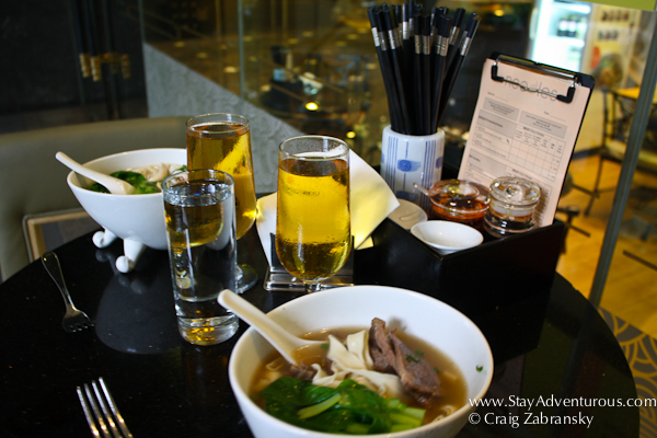 noodles and beer at the Noodle Bar inside the Orchard Hotel Singapore in Singapore