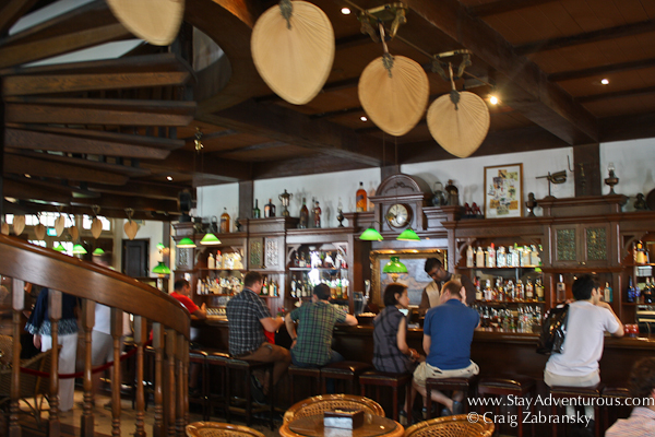 a look inside the long bar at the Raffles Hotel in downtown Singapore