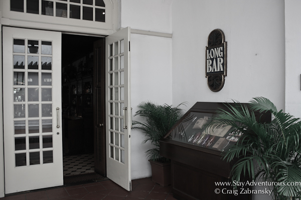 the entrance to the long bar at the raffles hotel in Singapore