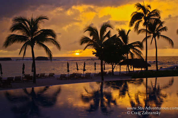 the sunset poolside at the St Regis Resort in Punta Mita Mexico
