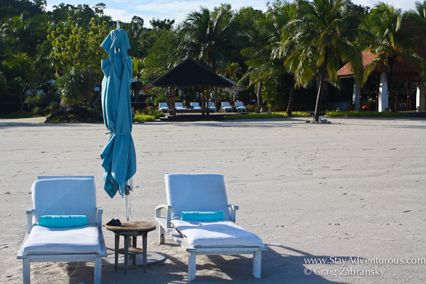 the beach at the Four Seasons Resort Langkawi Malaysia with lounge chairs