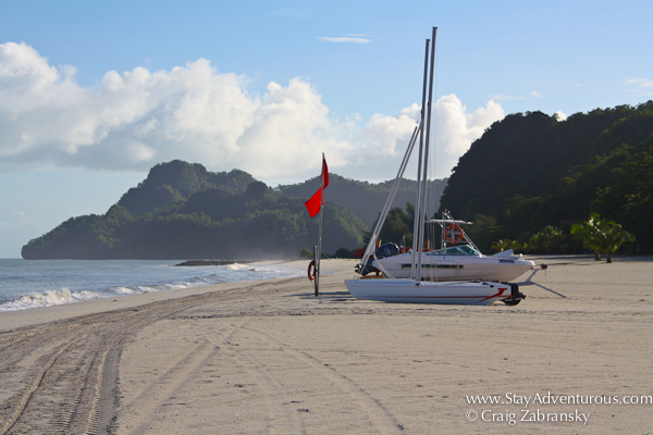 the beach at the Four Seasons Resort Langkawi Malaysia with a Hobie Craft