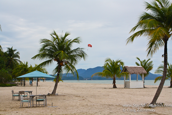 the beach at the Four Seasons Resort Langkawi Malaysia with a parasail