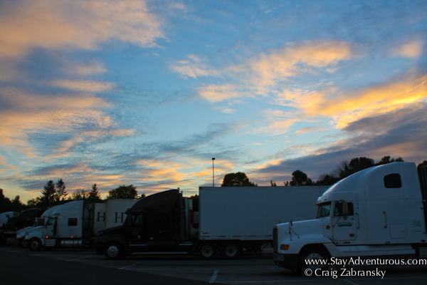 a sunset viewed from a rest stop on the new york state thruway
