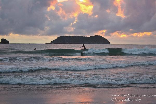 surfing at sunset in manuel antonio, costa rica... it's total Pura Vida!