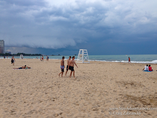 a storm rolls in of Lake Michigan at Oak Street Beach in Chicago