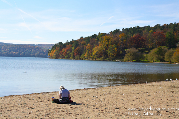 the beach at glimmerglass state park in the catskills of new york