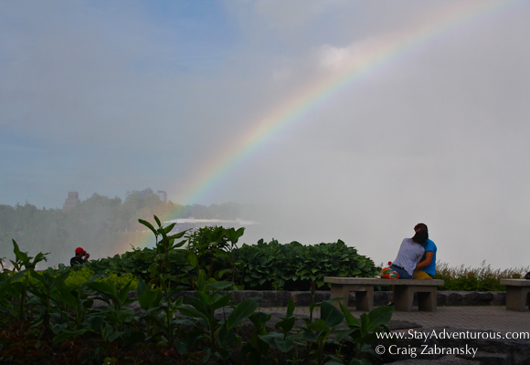 getting romantic at the Niagara Falls with a rainbow to set the mood