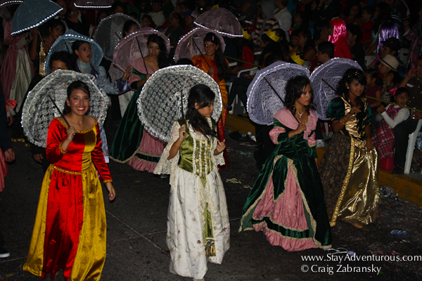 umbrella dancing at the carnaval parade on the malecon in mazatlan, sinaloa, mexico