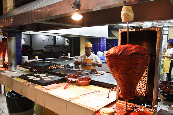 the tacos al pastor spit and pina at a local taquiera in mexico. culture thru cuisine