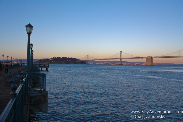pier 7 sunset in san francisco california with a view of the Bay Bridge