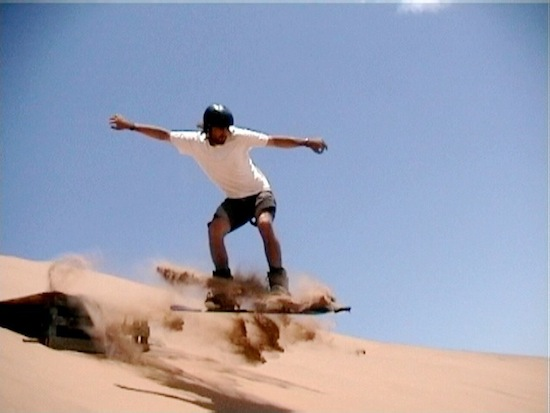 sand boarding on the desert sands of dubai in the middle east