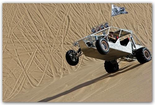sandbuggy or dunebuggy in the sands of the Dubai desert
