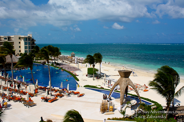 the view of the beach and one of the pools from a room at Dreams Riviera Cancun, Riviera Maya, Cancun, Mexico