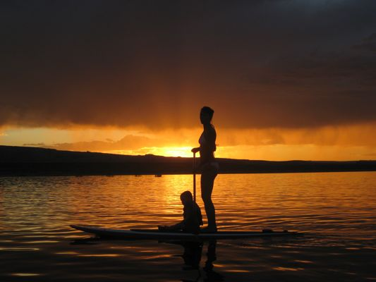 on the SUP Board Paddling oacross the Utah -Arizona border on Lake Powell with Sol Fitness Adventures