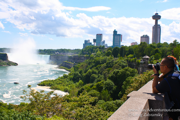a view of the Niagara Falls from the Canada Side, a photographer on the side