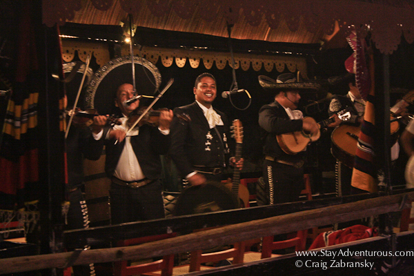 a boat of signing Mariachi inside Xoximilco Cancun in the Riviera Maya of Mexico
