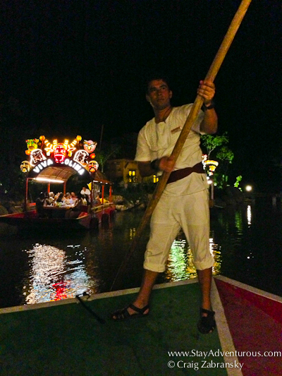 he navigates the boat through the Xoximilco Canals inside Xoximilco Cancun in the Riviera Maya of Mexico