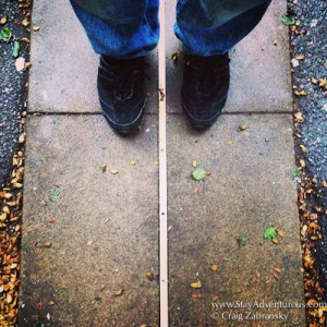 standing in the east and west, both sides of 0 longitude, the Prime Meridian in Greenwich, London, UK