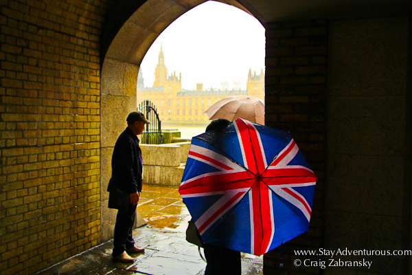 an unbrella designed as the union jack flag along the thames river in the capital city of london, united kingdom